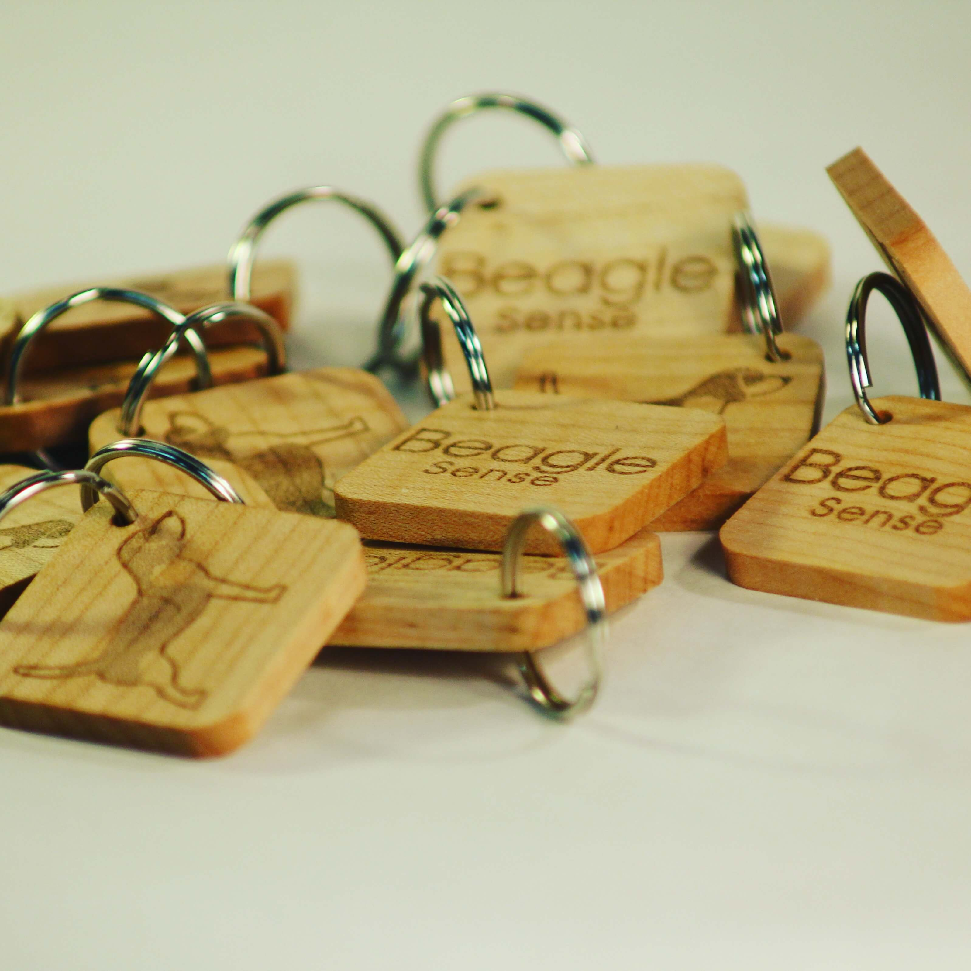 Keychain. Custom wood CNC keychain. Laser wood keychain. Ottawa Ontartio, Canada. All Things Made. Custom swag promo merch merchandise event. Beagel Sense.