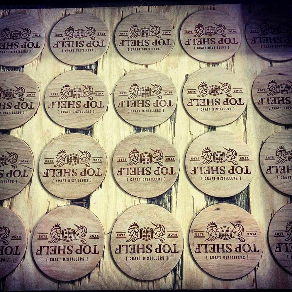 Custom wood laser coaster. CNC wood coaster. Branded promotional product. swag. Ottawa Ontario Canada. Top Shelf Distillery. Perth. barware. All Thigns Made.
