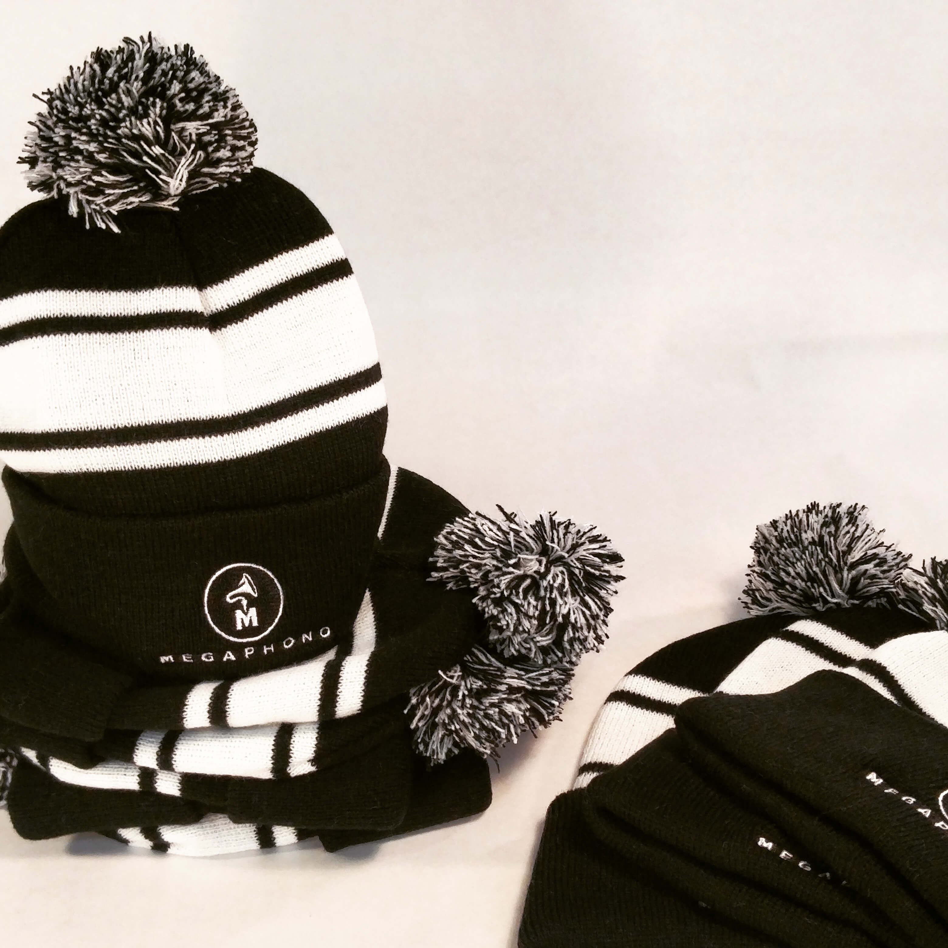 custom tuque, embroidered toque. Swag balck and white winter hat. Beanie. All Things made. Ottawa ontario. Canada. Promotional merchandise.