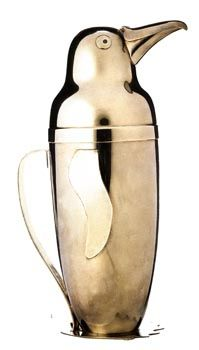 A vintage midcentury cocktail shaker in the shape of a penguin