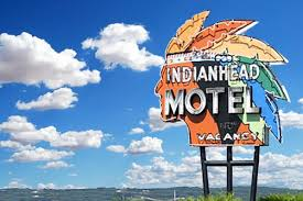 A daylight shoy of the classic mid-century Americana neon sign for the Indianhead Motel in Chippewa Falls, MI