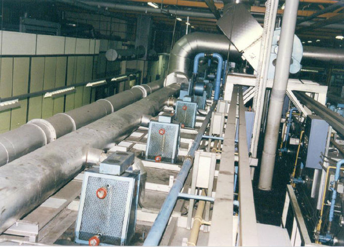 Multiple electro-lubers fitted to fans in a factory