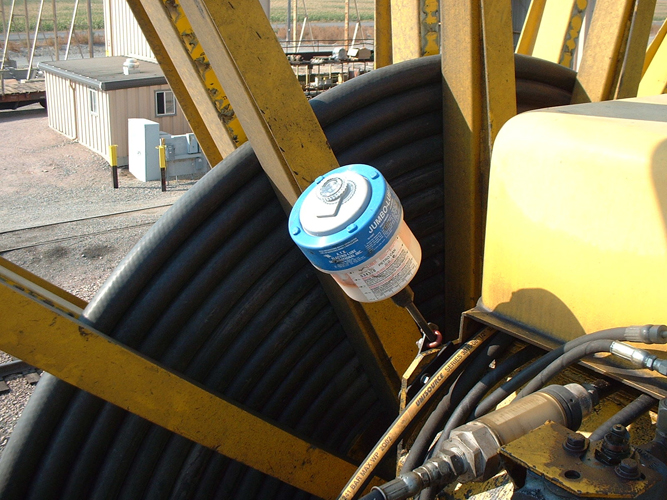 Electro-luber with blue Atex ring to certify that the single point automatic lubricator is Atex approved