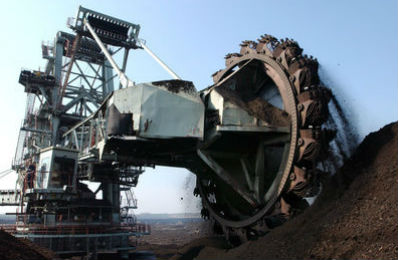 Large mining excavator being lubricated by Titan lubers