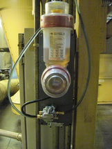 image of motor driven titan oiler lubricator attached to distribution block and lubricating multiple lubrication points