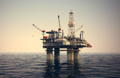 image of offshore oil rig that links to article on oil and gas indusry