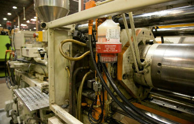 image of motor driven unit lubricating manufacturing machinery