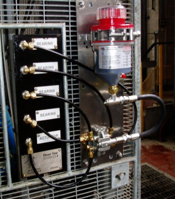 ATS Electro-lube Ultimate unit mounted to a distribution block, lubrication multiple ports