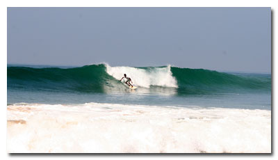 Surfing on the reef at Hikkaduwa