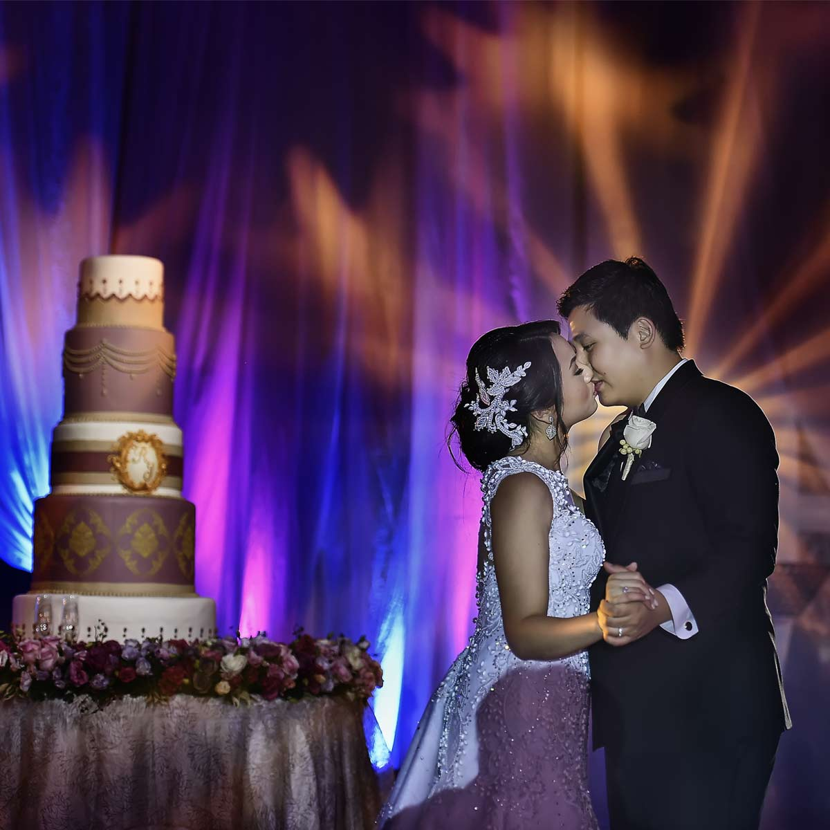 wedding cake with couple dancing with kiss shot by Benjamin Young III
