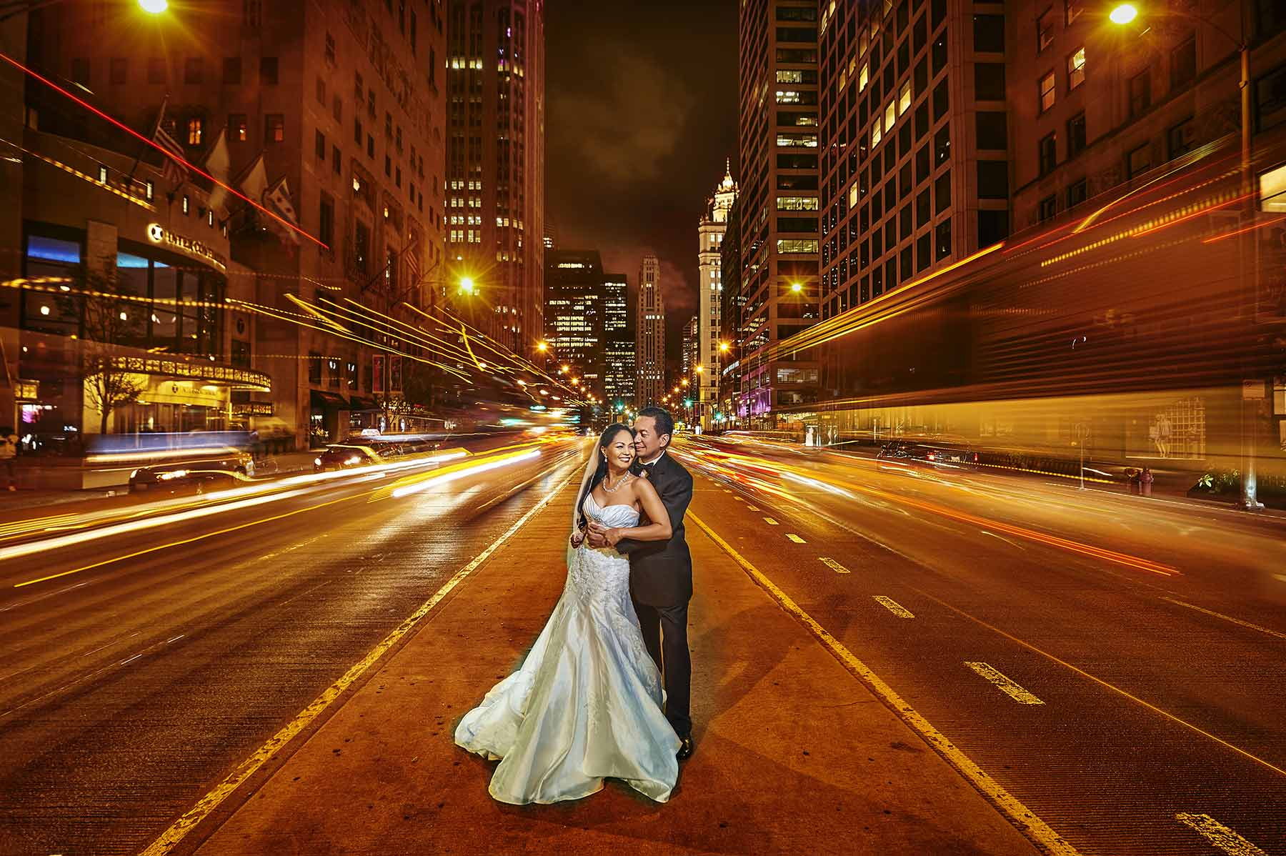 wedding couple being photographed at the middle of magnificent mile by Philippines wedding photographer Benjamin Young III