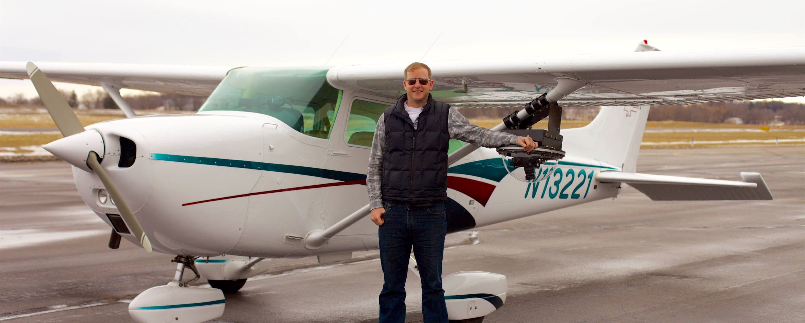 James Aarestad standing next to Cessna