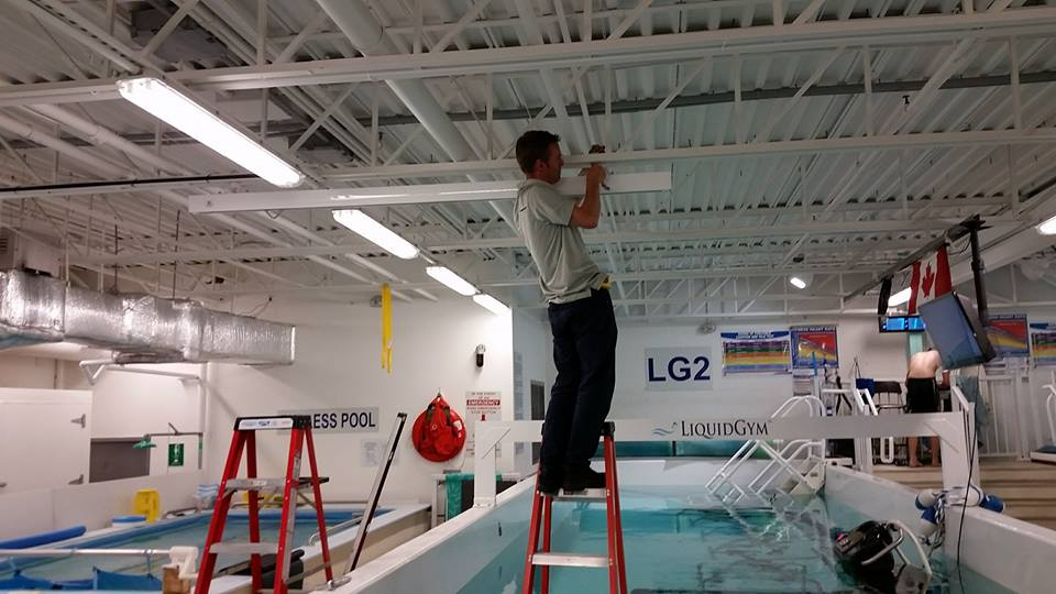 Installation of ceiling track at Liquid Gym in Ottawa.