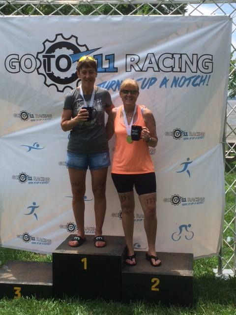 Mary Anne stands on the podium of a Go to 11 Race series race
