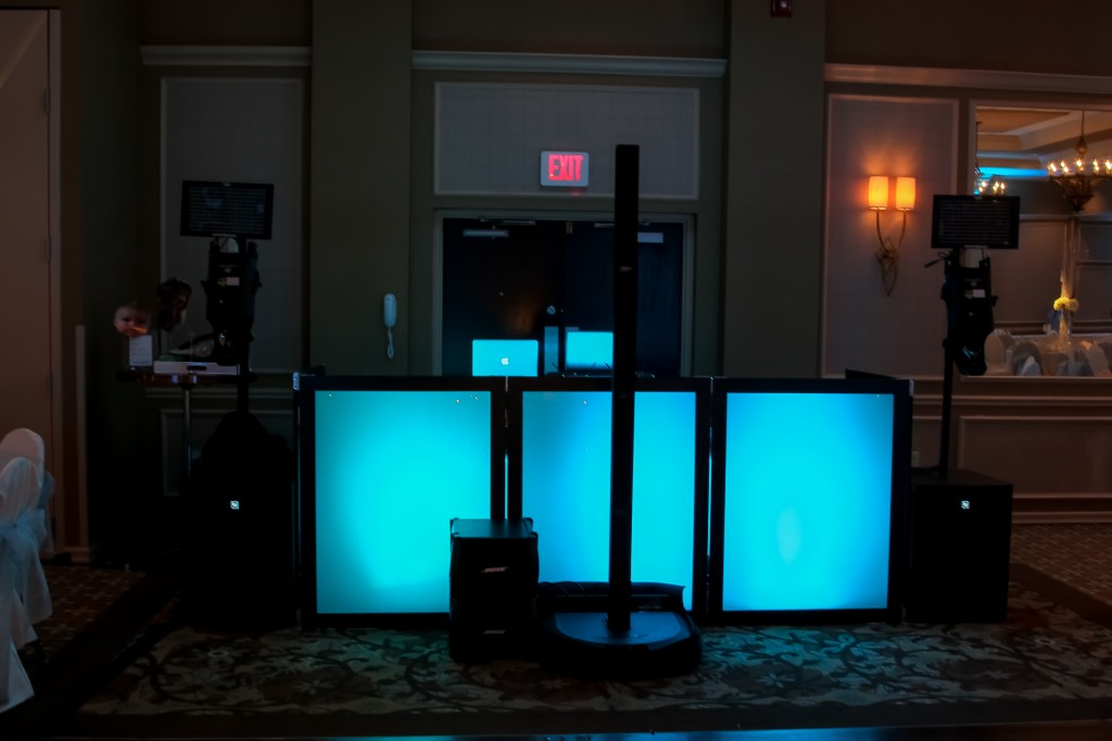 DJ facade set up with blue uplighting.