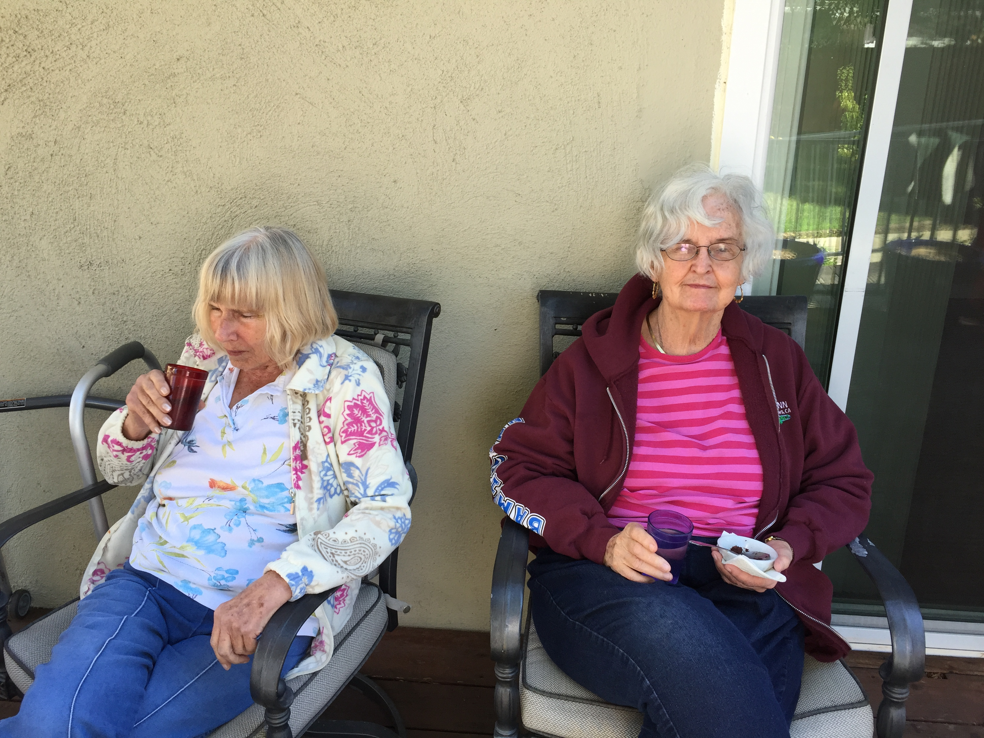 2 women having snacks out on the deck