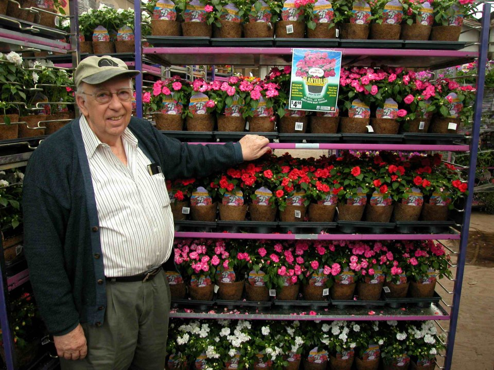 Robert Manugm with plants at his business in Montgomery County.