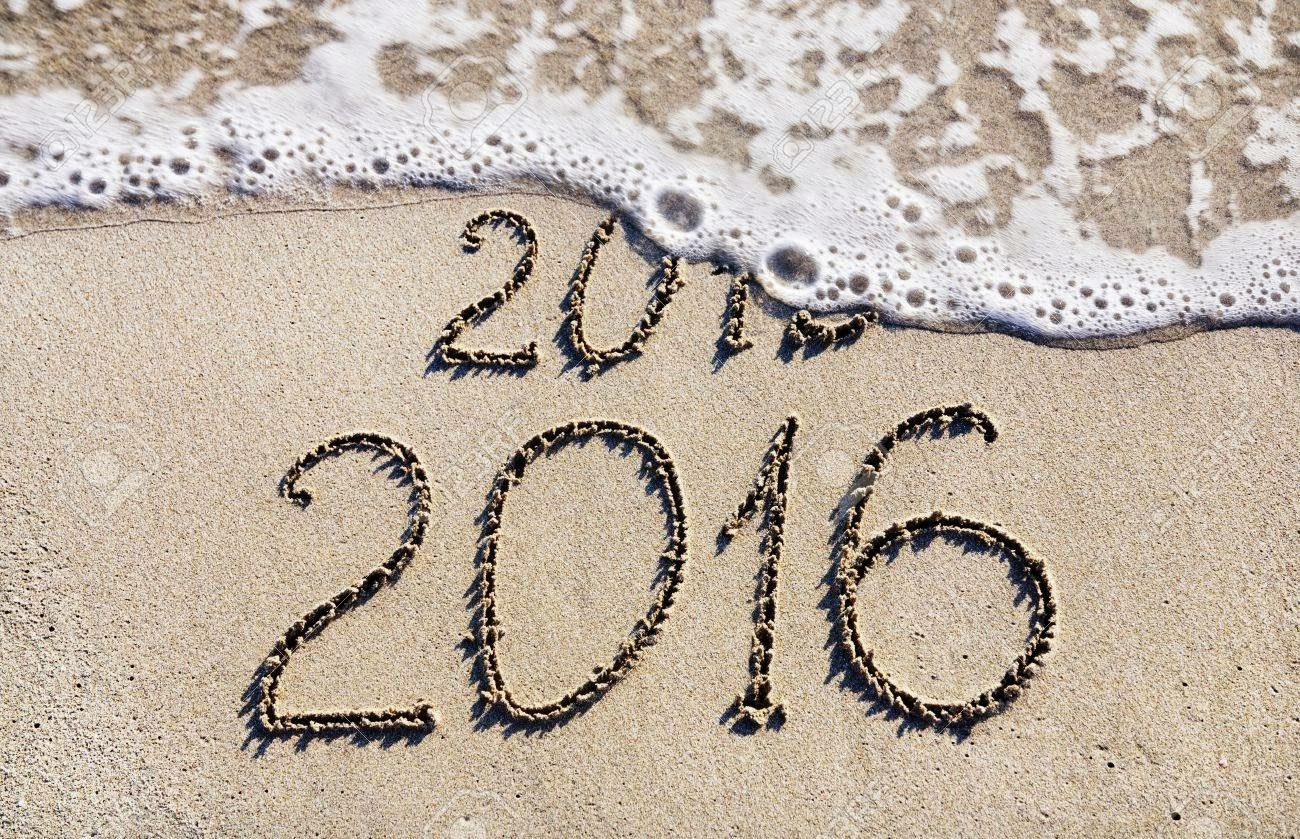 2015 ended 2016 started picture of sand with ocean washing over 2015