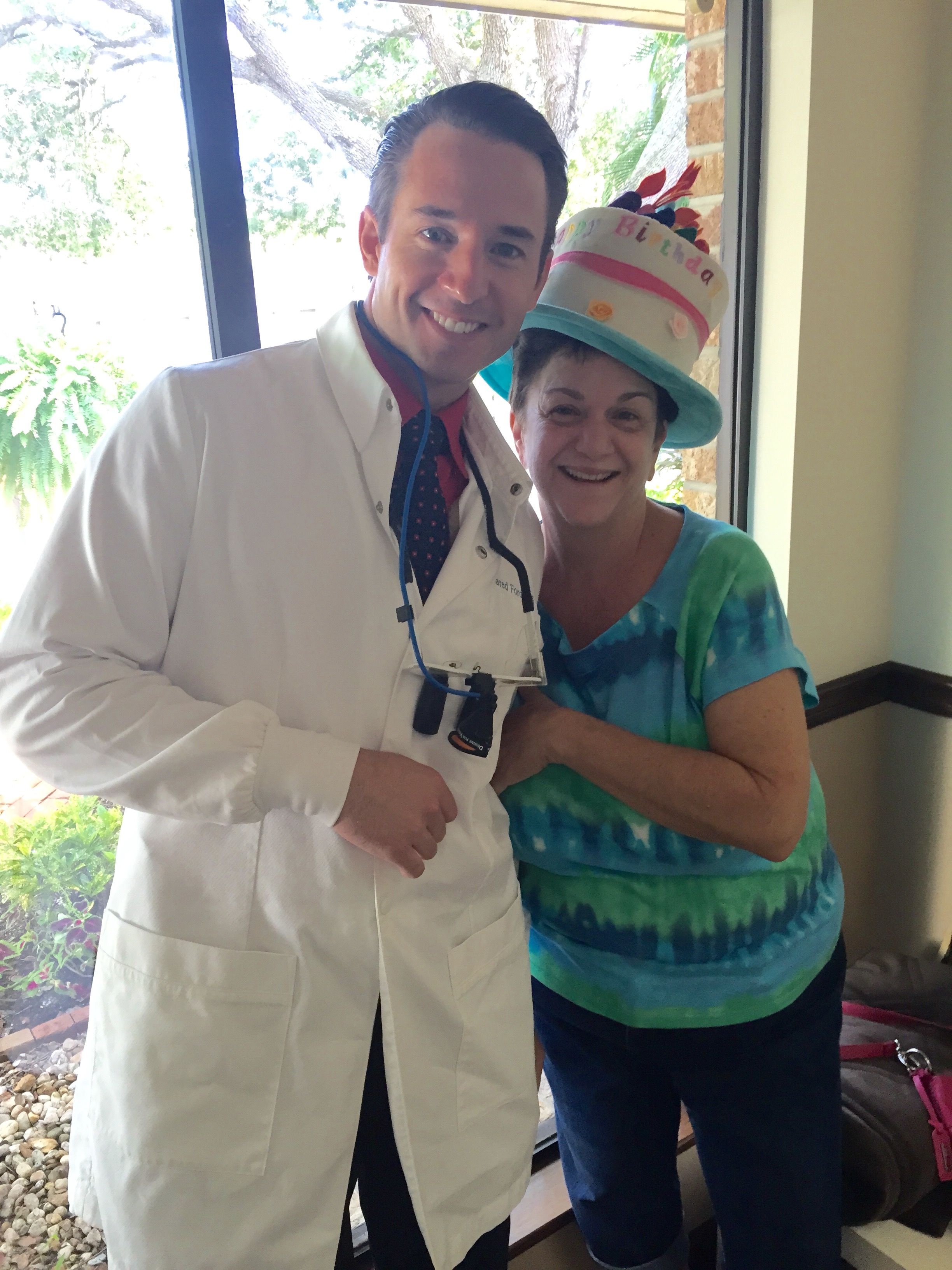 Friendly dentist Ft Myers Fl with patient