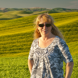 Teri Lou standing in a wheat field in the Palouse