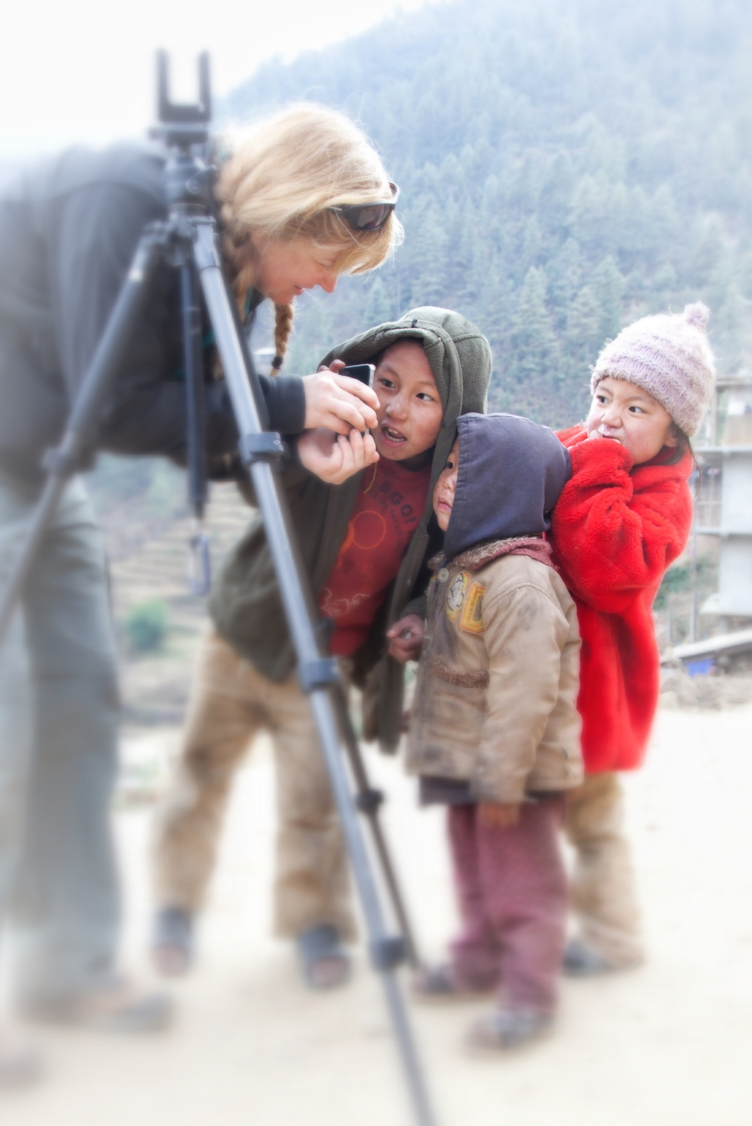 Teri Lou sharing a photo on the iPhone with chilren in Nepal
