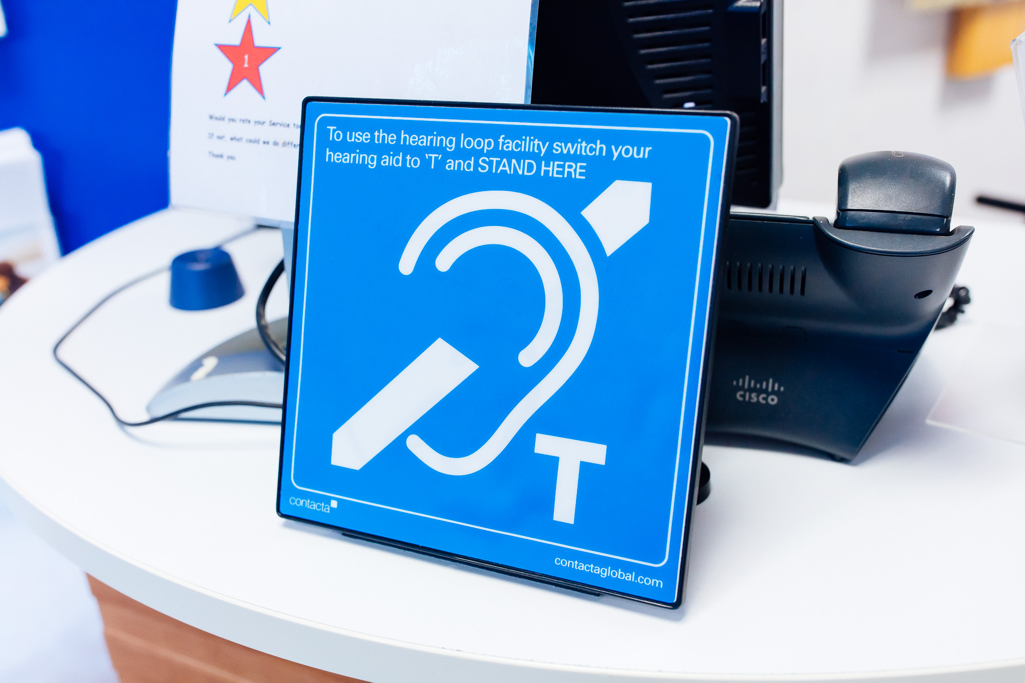 Contacta's hearing loop sign with built in aerial