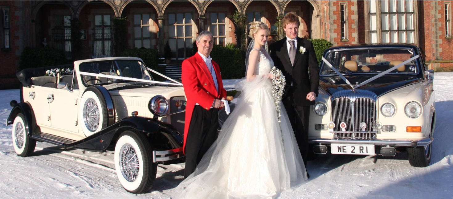 Photo of Toastmaster, Bride & Groom outside wedding venue with vintage cars in the snow