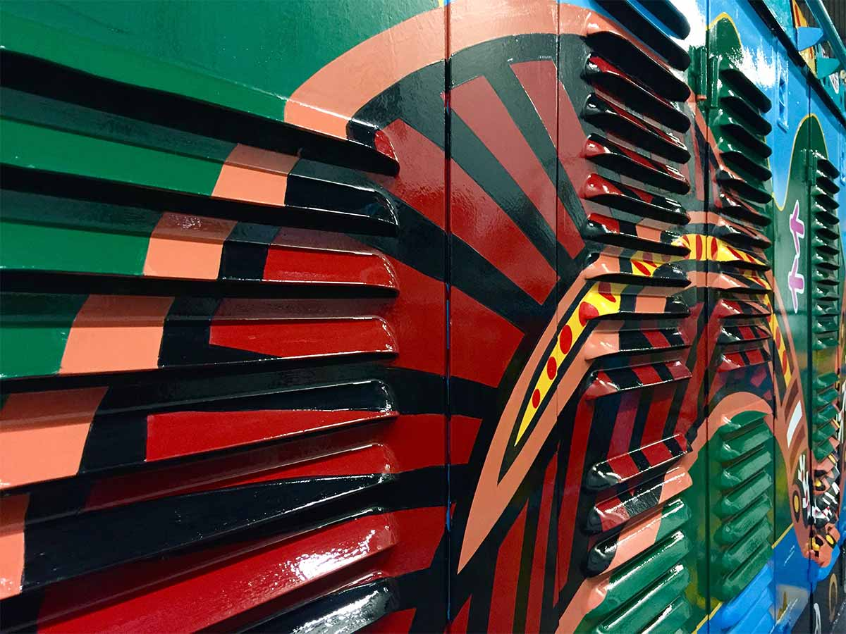 Close up of painted linework on vents to Kuranda Scenic Train locomotive on the left hand side, painted by Tom Cosic Art in 2016