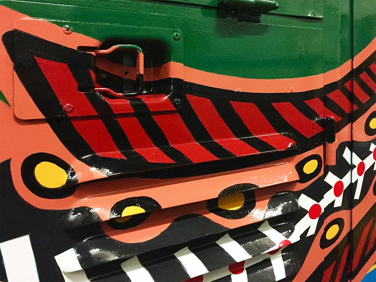 Close up of painted recessed handle to Kuranda Scenic Train locomotive, painted by Tom Cosic Art in 2016