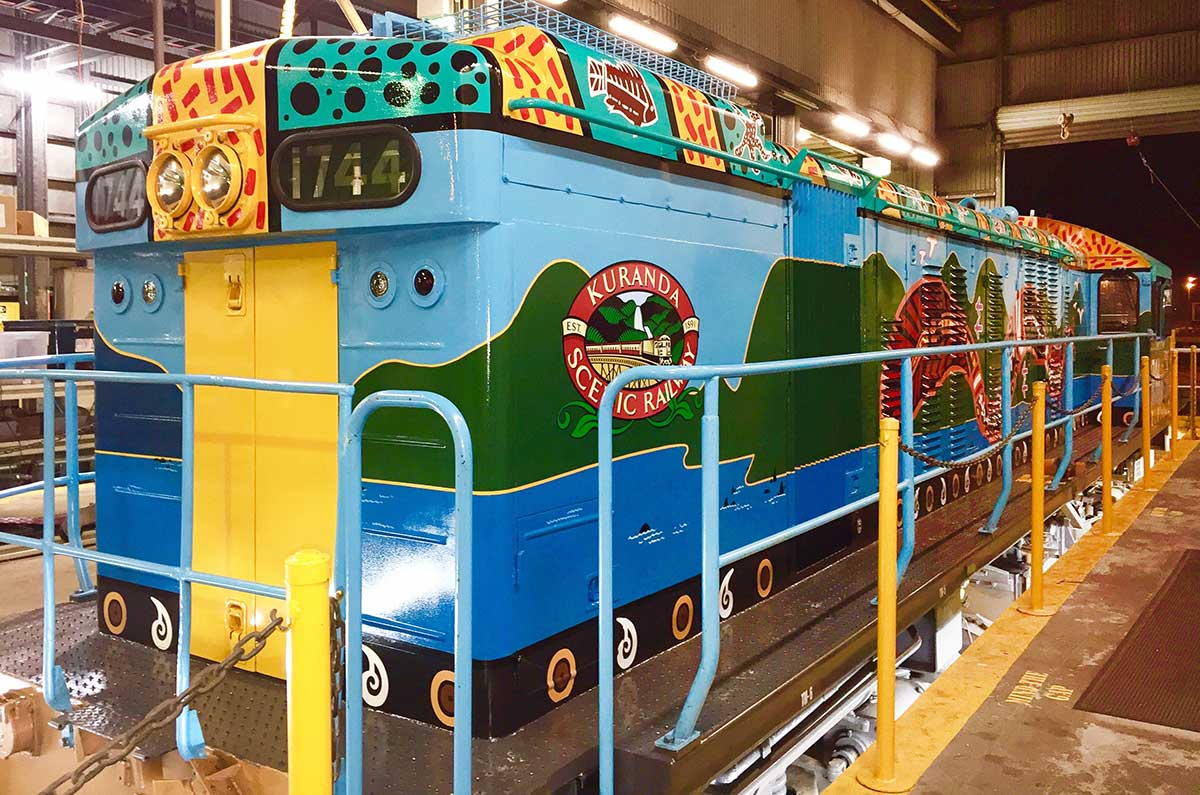 Rear right hand side of Kuranda Scenic Train locomotive painted by Tom Cosic Art  in 2016, in Cairns Queensland