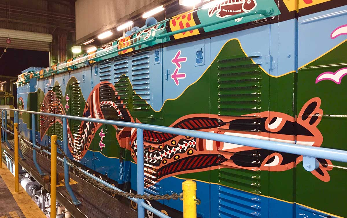 Painted imagery to right hand side of Kuranda Scenic Train locomotive, painted by Tom Cosic Art in 2016