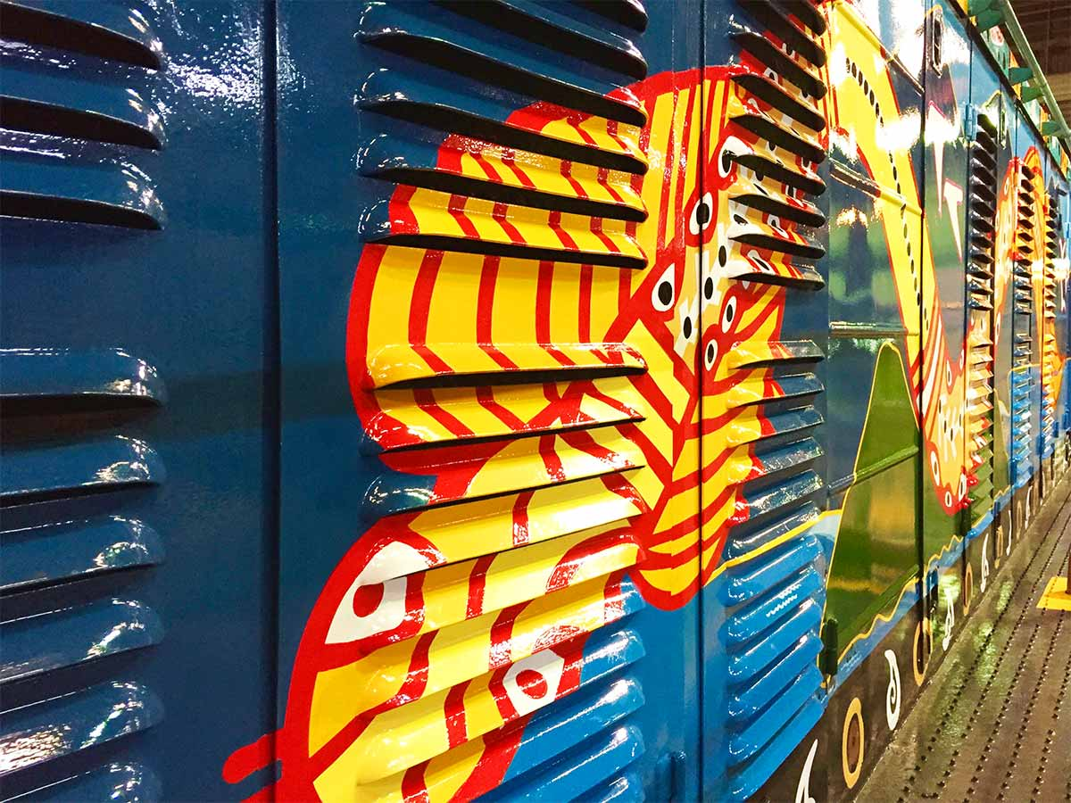 Close up of painted linework to vents on Kuranda Scenic Train locomotive on the right hand side, painted my Tom Cosic Art in 2016